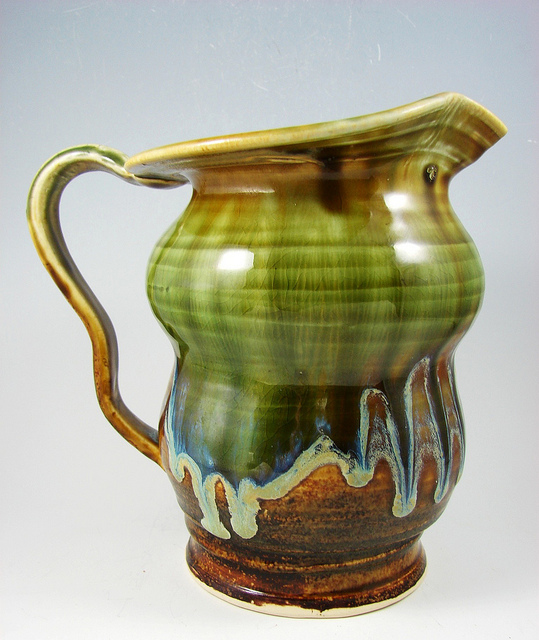 Handcrafted stoneware pitcher clay vessel