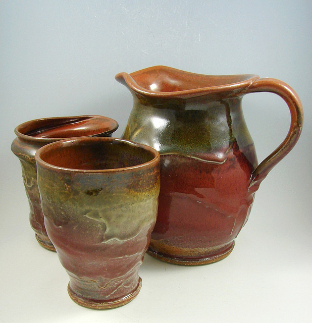 Sculptural stoneware water pitcher cups